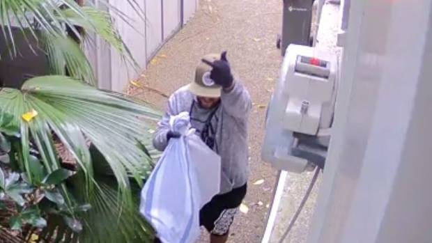 The burglar pulls the finger as he leaves with stolen items.