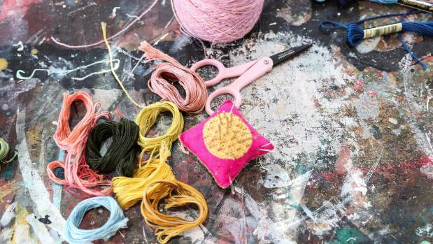 The tools of this artist are everything from acrylic paint to embroidery silks, vintage yarns, glass beads and gold thread.