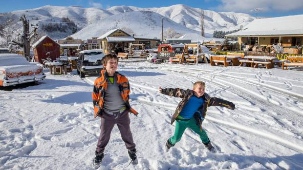 Christchurch brothers Riley Tammett 10 and Rocco 8 make the best of school holiday snow in Fairlie on Wednesday morning
