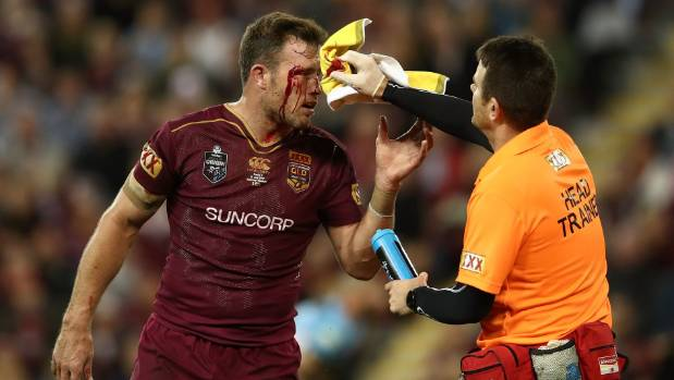 Queensland prop Gavin Cooper has a cut above his right eye treated during Game 3 of the State of Origin series.