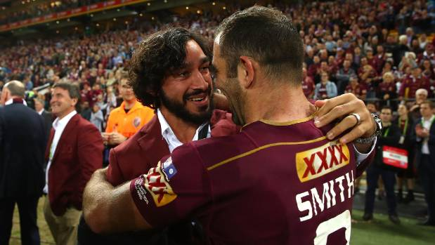 A tearful Johnathan Thurston (left) and Cameron Smith embrace after winning Game 3 of the State Of Origin series.