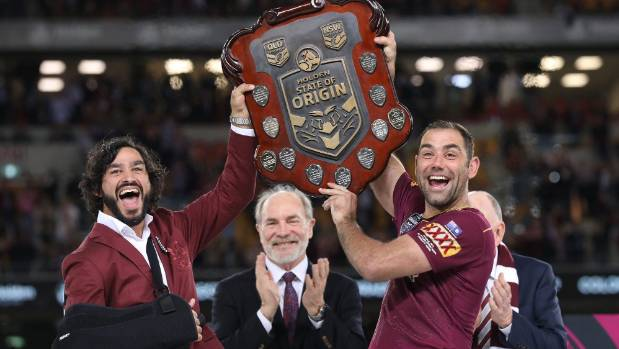 Cameron Smith (right) and Johnathan Thurston lift the State of Origin trophy after Queensland's 11th series victory in ...