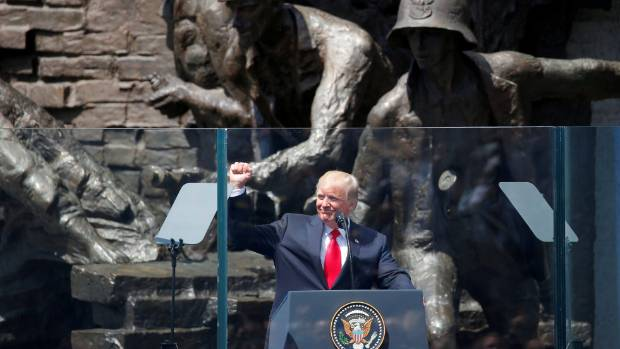 US President Donald Trump gives a public speech in front of the Warsaw Uprising Monument at Krasinski Square, in Warsaw, ...