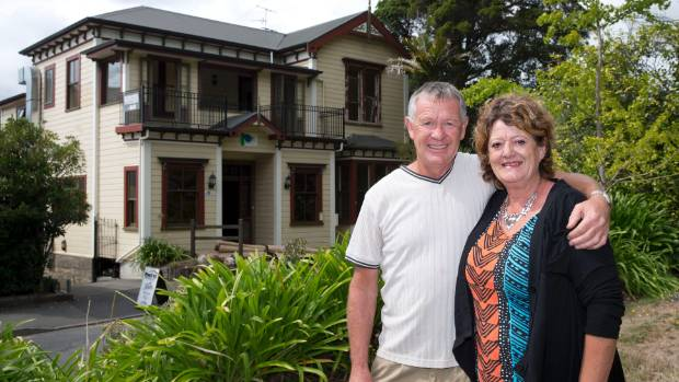 """Wayne and Anne Trott outside their boutique hostel that caters to a """"unique"""" market of backpackers."""