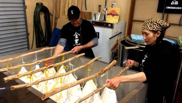 Dave and Yasuko Joll performing the first 'drip' press, which provides the premium shizuku sake.