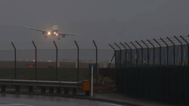 A plane lands at Wellington Airport on Thursday morning. Many other flights in and out of the capital were cancelled as ...