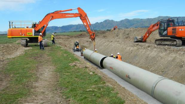 Workers lay new pipes for the Amuri Irrigation Scheme.