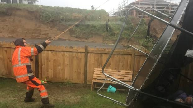 Jason Dahm battled the storm to save his runaway trampoline.