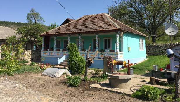 A traditional, brightly coloured homestead in Moldova.
