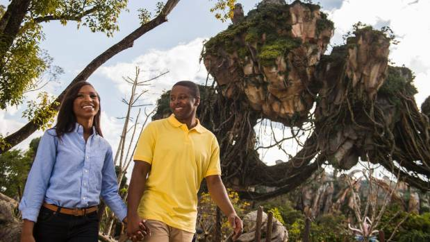 Floating mountains grace the sky while exotic plants fill the colorful landscape on Pandora - The World of Avatar at ...