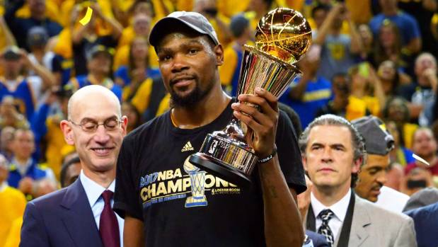 Golden State Warriors forward Kevin Durant poses with the NBA silverware last month.