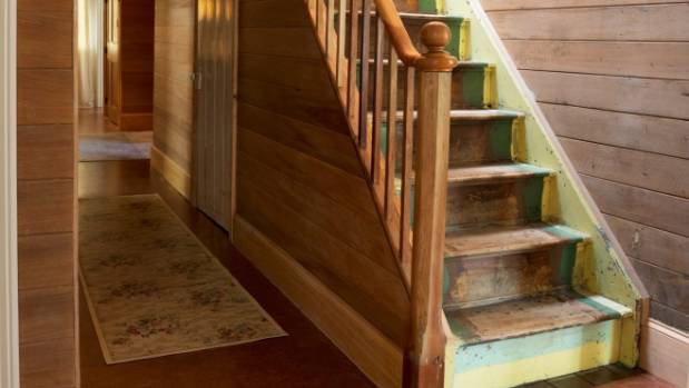 The 1880s staircase leads to the upstairs bedroom; the Cashmores have retained early linings and finishes behind the new ...