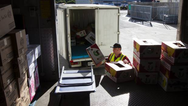 Kaibosh driver Lance Williams collects donated food from Countdown Petone which will soon be distributed to several ...