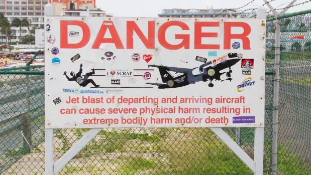 Warning signs at Maho Beach in St Maarten.