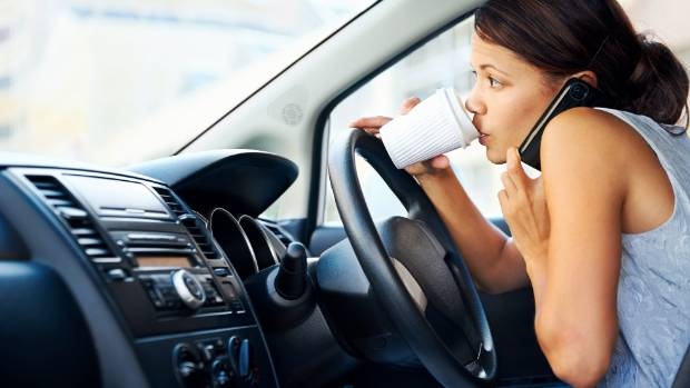 Oh the distractions - a new survey shows lots of motorists still drink and use their cellphones while driving.