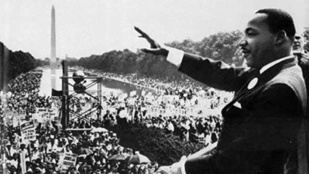 Martin Luther King waves to the crowd from the steps of the Lincoln Memorial in 1963, where he delivered his iconic 'I ...