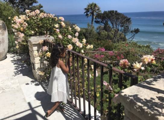 KIM KARDASHIAN: Here's little North West taking in the view in Malibu. Beaut garden and a gorgeous day, but I'm reminded ...