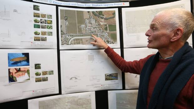 Council rivers investigation and planning engineer Jan ven der Vliet points out the planned stormwater upgrade to ...