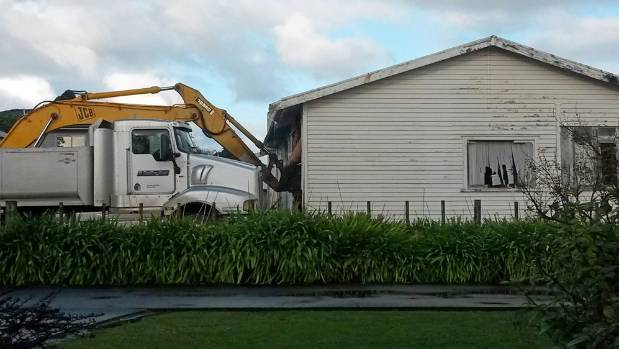 The back of the house being demolished by developers.