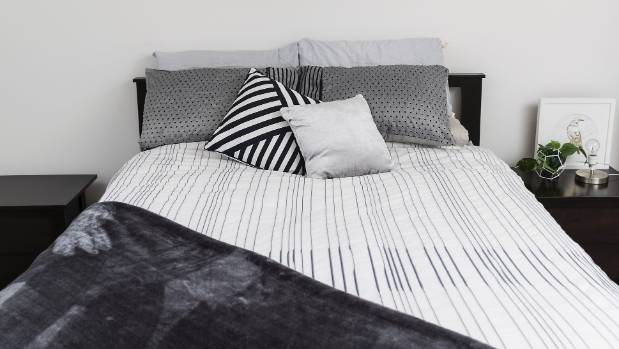 Monochrome bedding makes a chic statement in Simpson's bedroom.