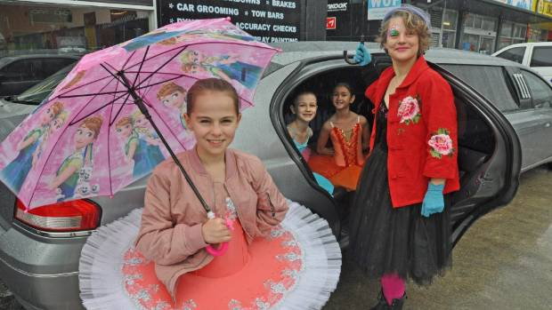 Corry Brown, 9,left and Hayley Jeffrey right stand in front of the limo that will be used for the Greenstone Doors ...