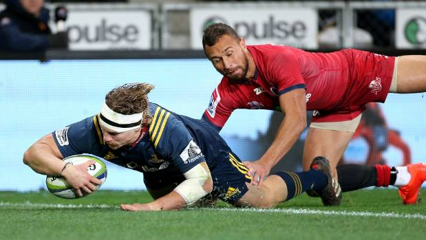 Highlanders flanker James Lentjes scores the Highlanders' second try against the Reds on Friday night. Quade Cooper is ...