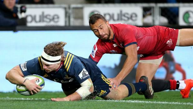 James Lentjes of the Highlanders dives over to score a try while in the tackle of Quade Cooper.