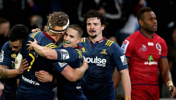 Highlanders players, left to right, Rob Thompson, James Lentjes, Kayne Hammington and Richard Buckman celebrate Lentjes ...