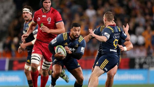 Highlanders first-five eighth Lima Sopoaga finds a gap against the Reds in Dunedin on Friday night.