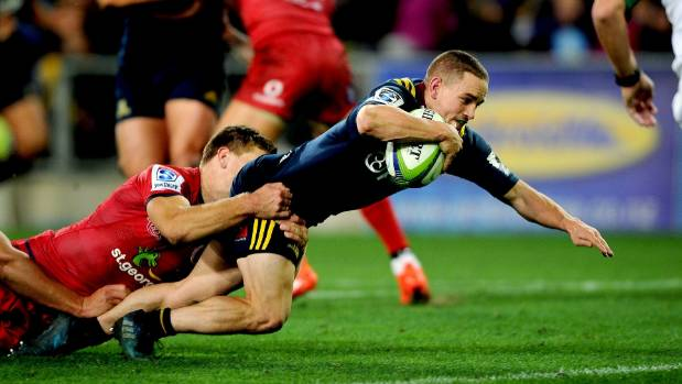 Highlanders halfback Kayne Hammington dives over for the Highlanders' third try against the Reds in Dunedin on Friday night.