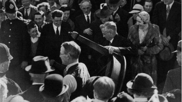 Shot at the opening of the Labour government's first state house at 12 Fife Lane, Miramar, Wellington, in 1937, this is ...