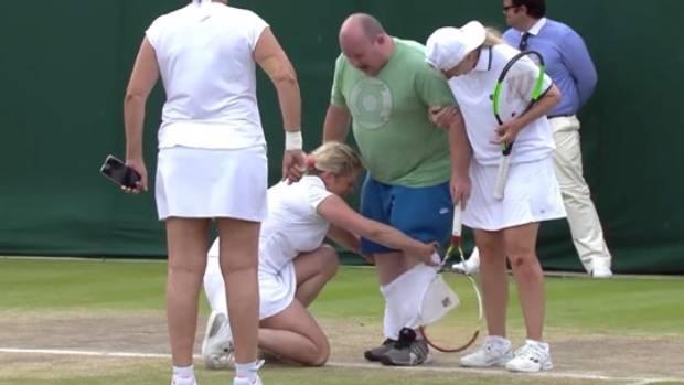 Tubby tennis fan tries to help Kim Clijsters in Wimbledon friendly match