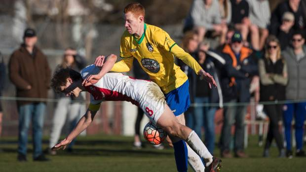 Cashmere Technical's Jordan Halligan challenges Caversham skipper Andrew Ridden during their Chatham Cup last 16 clash ...
