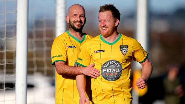Cashmere Technical's Michael White, right, is congratulated by team-mate Stu Kelly after scoring the opening goal ...