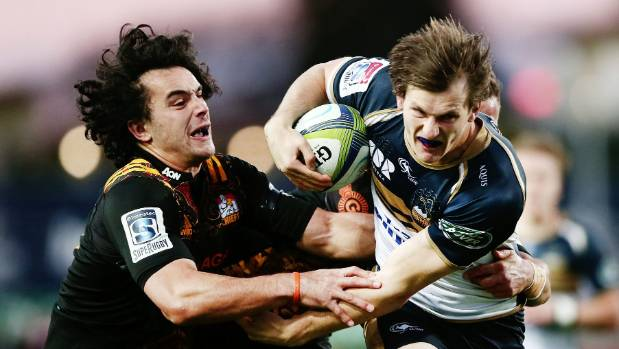 James Dargaville of the Brumbies on the charge against James Lowe of the Chiefs.