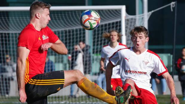 Western Suburbs' Callum McCowatt (right) and Stop Out's Kade Schrijvers compete for possession at Hutt Park on Saturday.