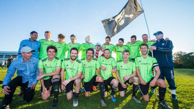 The victorious Central Pirates football side celebrate Knockout Cup success at A and P Park on Saturday.