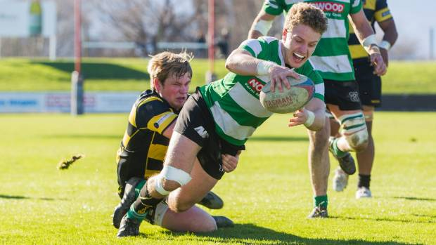 Chris Bolton of Renwick dives over the line to score his side's final try with Waitohi fullback Corey Bovey trying to ...
