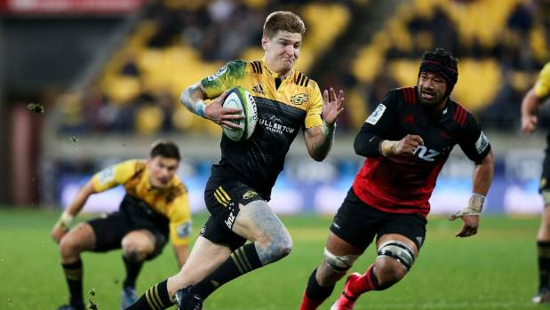 Jordie Barrett of the Hurricanes breaks away for a try against the Crusaders.