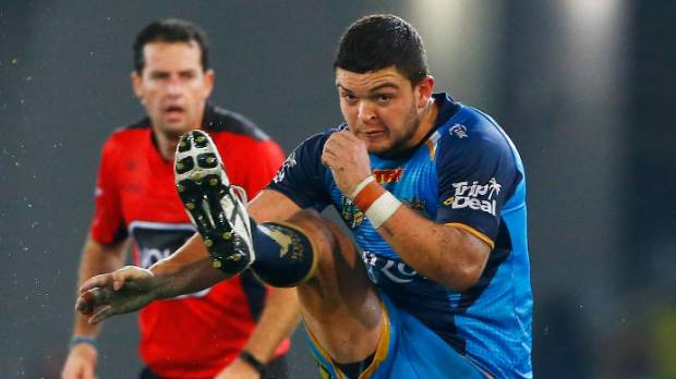 Titans halfback Ash Taylor mastered the tricky conditions as others around him struggled.