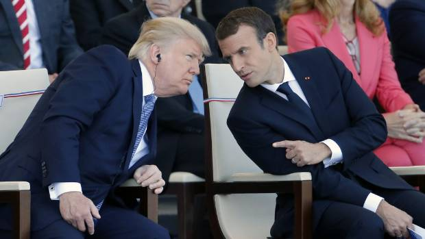 French President Emmanuel Macron, right, hopes he's changed US President Donald Trump's mind about climate change.