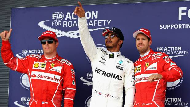 The top three qualifiers for the British Grand Prix: Lewis Hamilton (centre), and Ferrari team-mates Kimi Raikkonen and ...