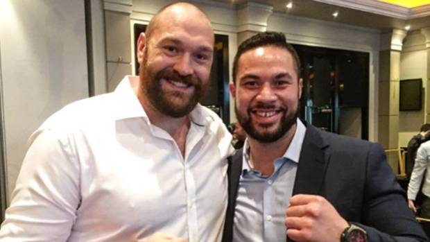 Tyson Fury and Joseph Parker get cozy at a news conference for the Kiwi heavyweight boxer's upcoming fight with the ...
