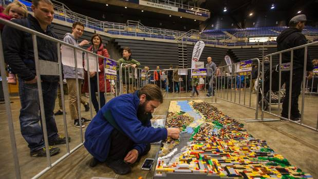 Matthew Bennett works on a Lego scene of Mt Cook and Lake Pukaki using official map data at the Christchurch Brick Show ...