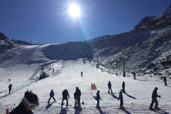 Blue skies and warm, sunny conditions greeted snow-enthusiasts on opening day at Rainbow Ski Area on Saturday.