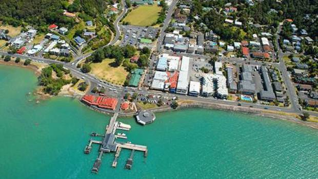 Tourists flock to the water-front town of Paihia in the summer months.