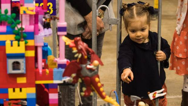 Lily-Rose Hall, 2, looks at a fantasy castle exhibit annual show.