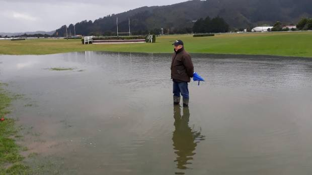 Wellington Racing Club track manager Kim Treweek surveys the ponding that caused the cancellation of Trentham's big ...