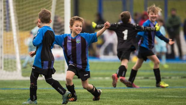 Selwyn player Vlad Novikov and his teammates celebrate a goal in a tightly-fought under 9 match at the Christchurch ...