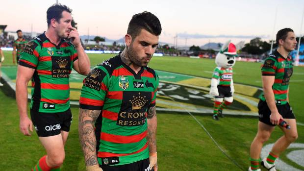 Adam Reynolds and his Rabbitohs team-mates contemplate the end of their NRL season after defeat to the Cowboys in Cairns.